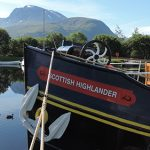Scottish Highlander moored in front of Ben Nevis