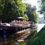 Hotel Barge Luciole river cruise through trees Bailly